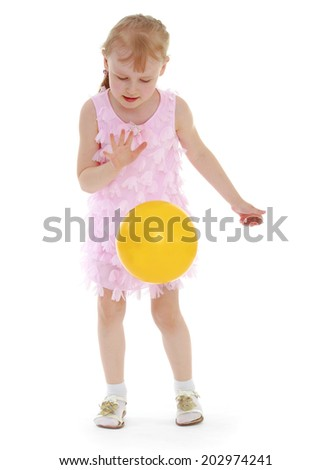 ilittle girl tosses the ballsolated on white background, sports life,happiness concept,happy childhood,carefree childhood,active lifestyle
