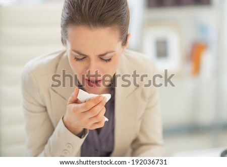 Ill business woman in office - stock photo