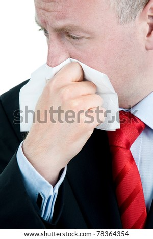 Ill Businessman with tissue suffering from cold and flu or Allergy - stock photo