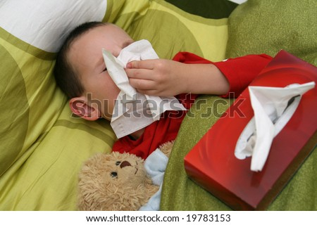 Ill child with catarrh and tissue - stock photo