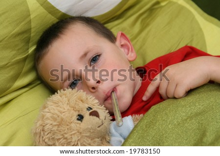 Ill child with flu and fever - stock photo