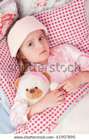 Ill girl with teddy bear in the bed ( No-name teddy bear ) - stock photo