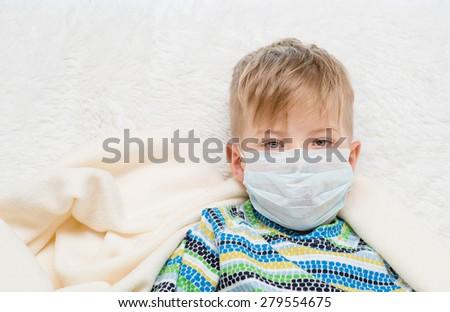 ill little boy in medicine health-care mask  - stock photo