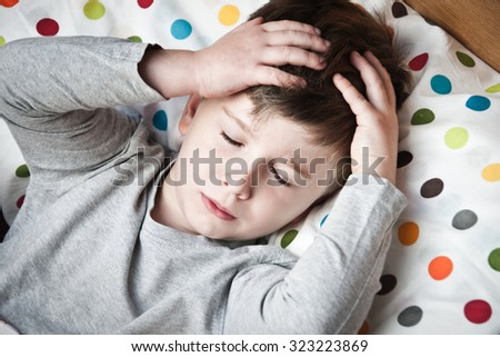 Ill little boy in the bed. - stock photo