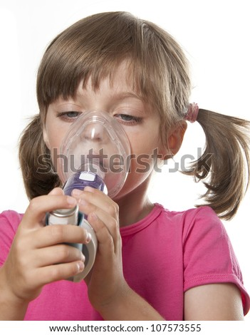 ill little girl with inhaler - respiratory problems - stock photo