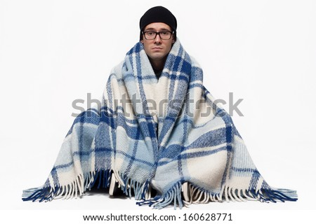 Ill Man covered with plaid blanket isolated against white background - stock photo