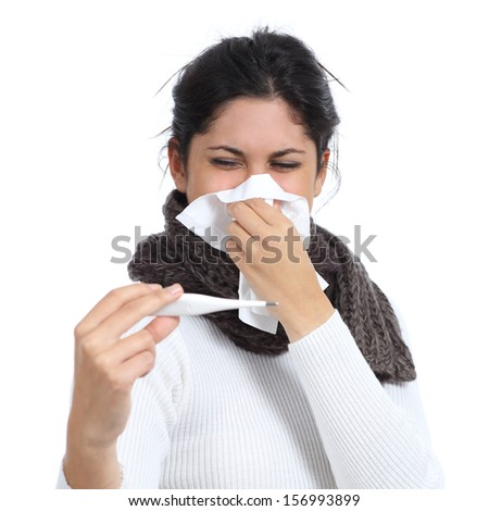 Ill woman with a handkerchief in the nose looking a digital thermometer isolated on a white background - stock photo