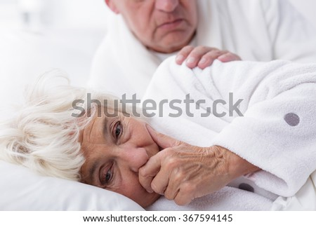 Ill woman with influenza coughing in bed - stock photo