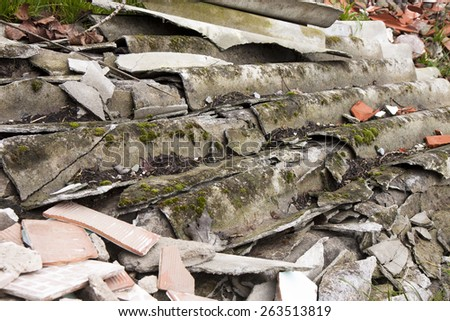 Illegal asbestos dumping. Roofing asbestos panels illegally abandoned in nature - stock photo