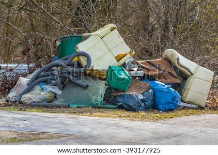 Illegal bulk waste discarded - stock photo