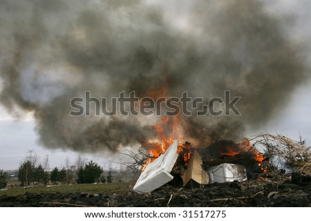 illegal burn refuse, poisonous smoke of polystyrene foam, fire and fumes, clouds of toxic smoke