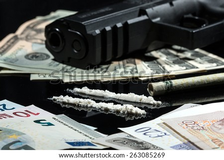 Illegal drugs , money and guns  - stock photo