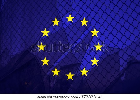 Illegal or legal immigration concept Background of transparent Euro union flag behind a chain link fence and broken glass in the window - stock photo