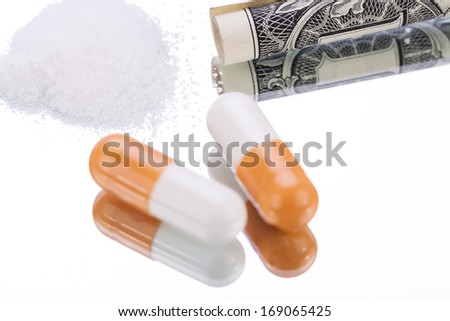 illegal pharmaceutical pills and drugs money on mirror addiction objects - stock photo