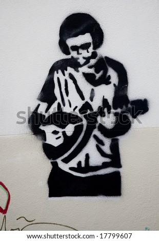 illegal stencilled and sprayed street art - stock photo