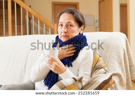 Illness woman doing home therapy - stock photo