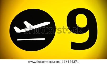 Illuminated Airport Departure Gate Sign - stock photo