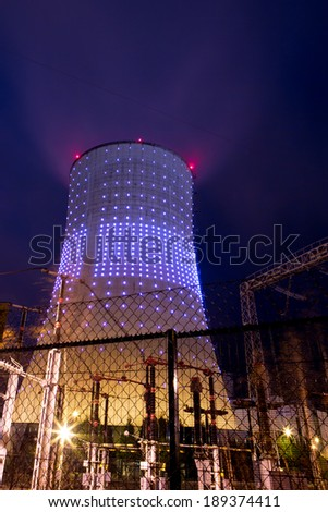 Illuminated and creative power plant at night in Brussels. Long time exposure. - stock photo