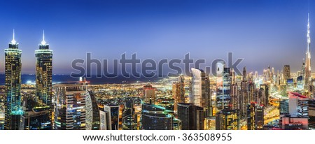 Illuminated architecture of Dubai downtown, United Arab Emirates. Scenic nighttime skyline. - stock photo