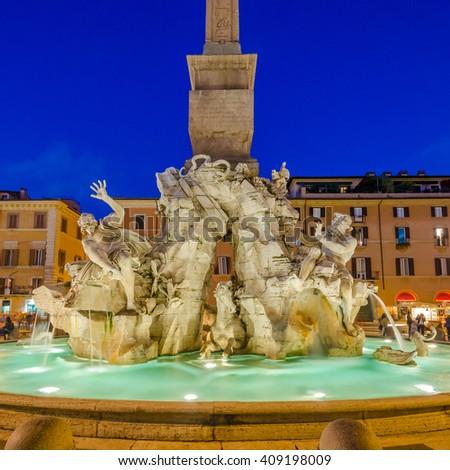 Illuminated at night the Fiumi Fountain on Piazza Navona, Rome, Italy. - stock photo