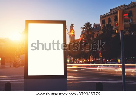 Illuminated billboard with blank copy space screen for your advertising text message or promotional content, empty Light-box for information with night city on background, clear poster in urban scene - stock photo