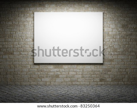 Illuminated blank advertising billboard on a brick wall - stock photo