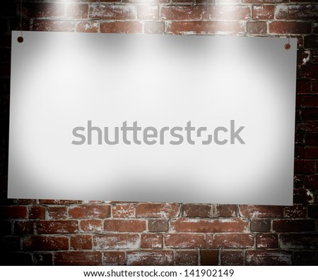 illuminated blank banner in the background of an old brick wall
