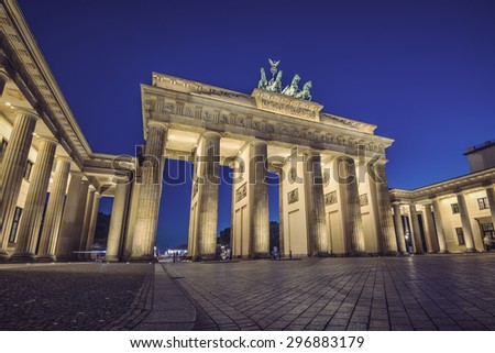 illuminated Brandenburg Gate (Brandenburger Tor) at evening, Berlin, Germany, Europe, vintage filtered style - stock photo