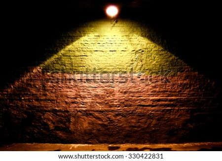 Illuminated brick wall background - stock photo