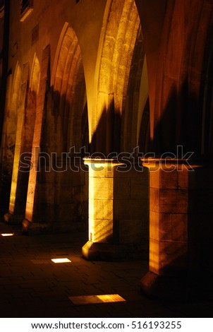 Illuminated building with arches