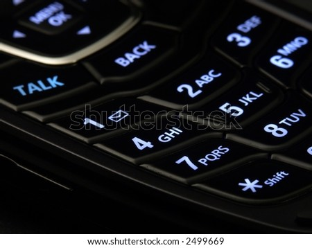 Illuminated cell phone keypad. - stock photo
