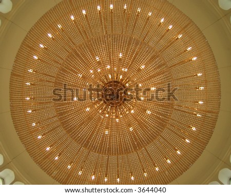 Illuminated chandelier viewed from directly below. - stock photo