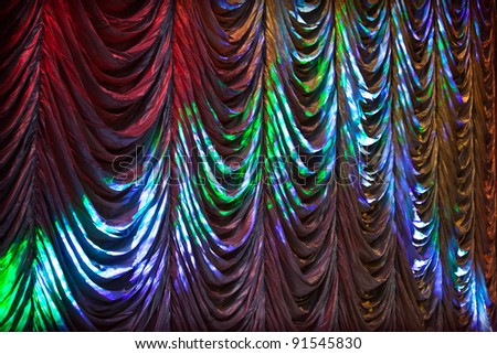Illuminated colorful curtain background texture - stock photo