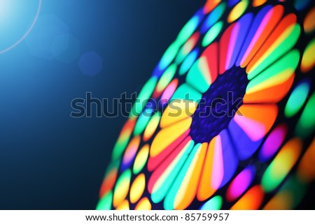 Illuminated colorful spectrum spinning wheel, motion blur background. - stock photo