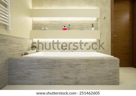 Illuminated comfortable bath in luxury bathroom - stock photo