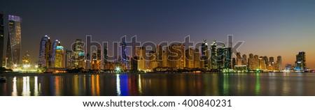 Illuminated Dubai Marina Cityscape United Arab Emirates architecture - stock photo