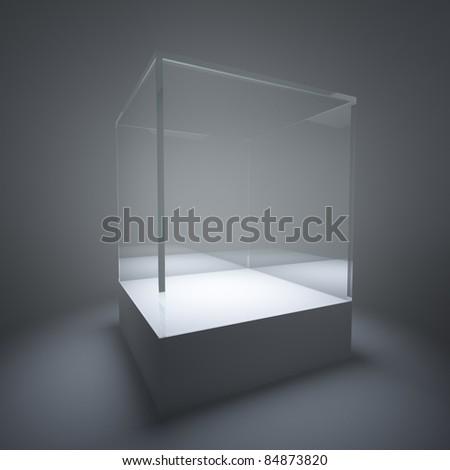 Illuminated empty glass showcase in room - stock photo