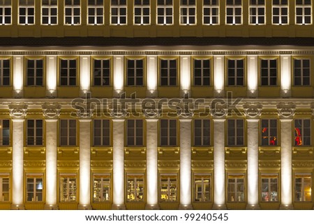 Illuminated facade in Munich, Germany, at night - stock photo
