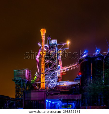 Illuminated factory plant at night - stock photo