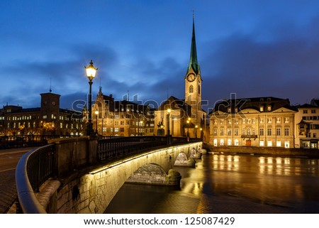 Illuminated Fraumunster Church and River Limmat in Zurich, Switzerland - stock photo