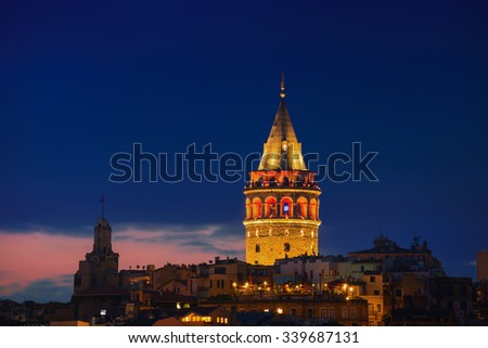 Illuminated Galata Tower in Istanbul, Turkey with dark blue sky at the background - stock photo