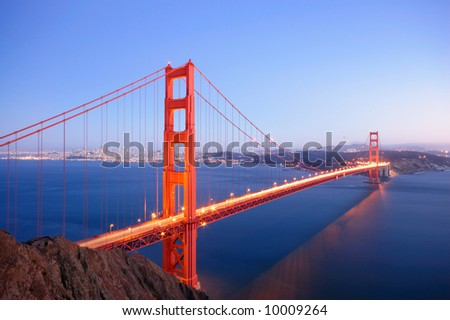 Illuminated Golden Gate Bridge glows in the dusk on an autumn evening. - stock photo