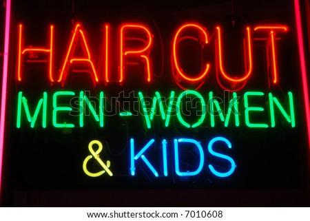 """Illuminated """"Hair Cut Men - Women & Kids"""" neon sign - stock photo"""