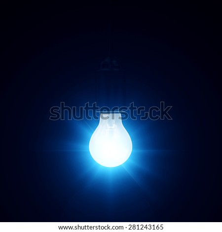 Illuminated Hanging Light Bulb on blue dark background - stock photo