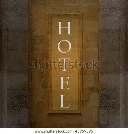Illuminated hotel sign - stock photo