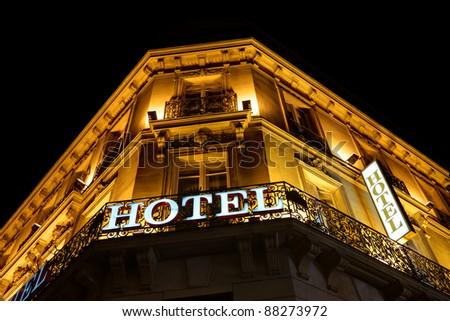 Illuminated hotel sign taken at night - stock photo