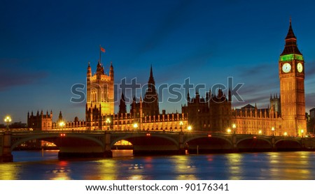 Illuminated Houses of Parliament at twilight - HDR version, London, England - stock photo
