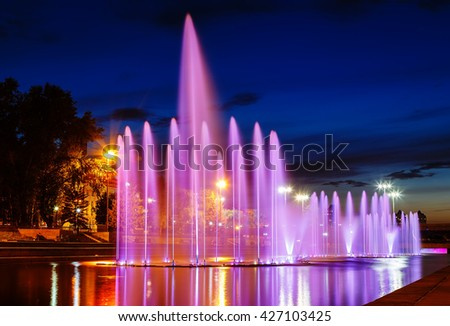 illuminated in different colors at night fountains. Summer Yekaterinburg downtown.