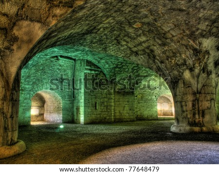 Illuminated interior of the ancient fortress Munot in Switzerland (hdr version) - stock photo