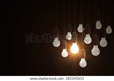 Illuminated Light Bulb Hanging out from the others Light Bulbs. Individuality Conceptual Background - stock photo